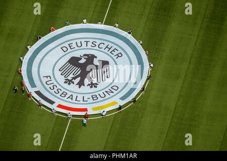 Aerial view, youth players practice rolling out the emblem of the German Football Association, Stadium Niederrhein, Stadion SC Rot-Weiß Oberhausen e.V - Stock Photo