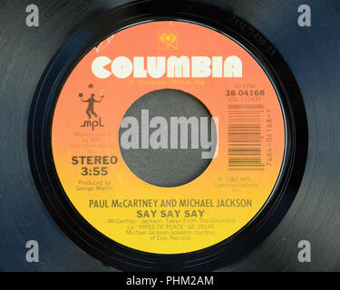 Close-up of the 45 RPM vinyl record of Paul McCartney and Michael Jackson's song 'Say Say Say' released in 1983 by Columbia Records. - Stock Photo