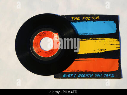 Cover and 45 RPM vinyl record of The Police's song 'Every Breath You Take' released in 1983 by A&M Records. - Stock Photo