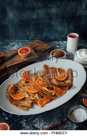 Pancakes with blood oranges - Stock Photo