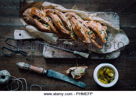 Twisted rye bread with oil - Stock Photo