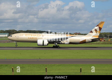 A6-DDD, a Boeing 777-FFX operated by Etihad Cargo, arriving at Prestwick Airport to collect horses used at the Edinburgh Military Tattoo. - Stock Photo