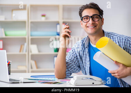Young designer working on new project and choosing colours - Stock Photo