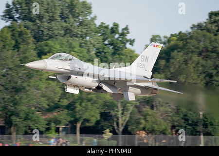Oshkosh, WI - 28 July 2018:  A F-16 flying falcon is doing a low pass at the EAA airshow. - Stock Photo