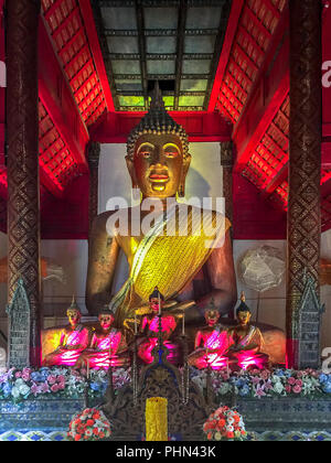 Golden Buddha inside Wat Phakhao temple at Chiang Mai, Thailand. Red room - Stock Photo