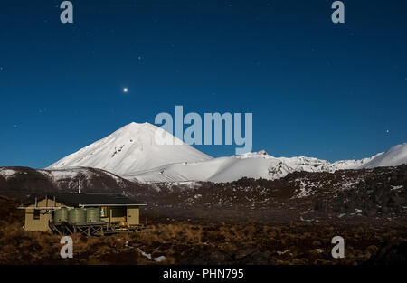 Venus over the crater of Mount Ngauruhoe with Oturere hut in the foreground - Stock Photo