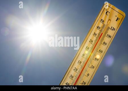 Mercury thermometer Summer heat Sun light - Stock Photo