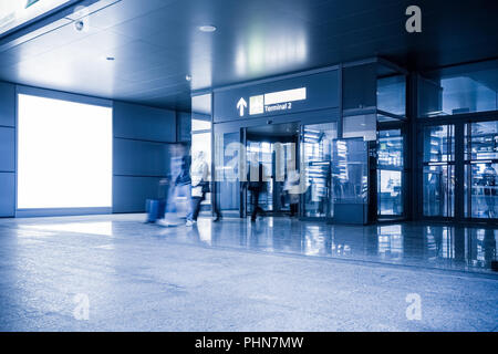 blank advertising lamp box in airport terminal - Stock Photo