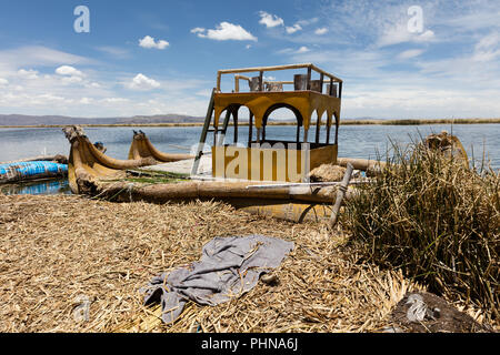 Totora boat on the Titicaca lake near Puno, Peru - Stock Photo