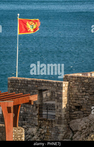 Flag of Montenegro fluttering in a wind - Stock Photo