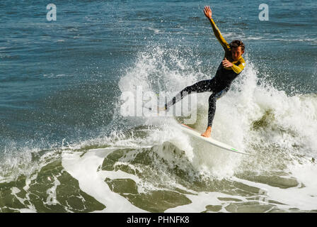 Surfer carving a wave at Jacksonville Beach, Florida. (USA) - Stock Photo