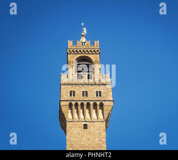 Detail of the bell tower of Palazzo Vecchio in Florence - Stock Photo