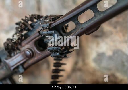 Detail of an old disused machine gun - Stock Photo