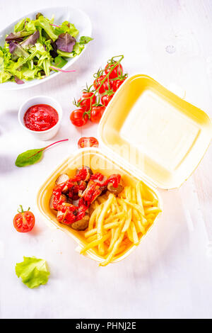 grilled bratwurst with French fries and ketchup - Stock Photo