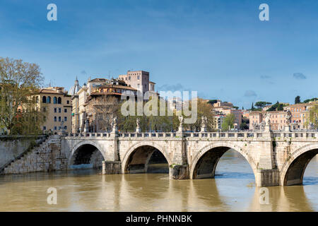Rome downtown skyline with bridge on river Tiber at sunny day in Rome, Italy. - Stock Photo