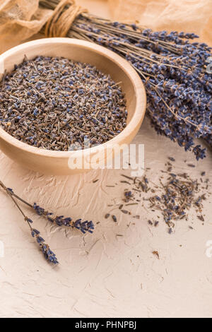 Wellness care products with lavender seeds in a bowl - Stock Photo