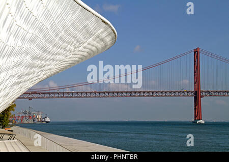 The 'Ponte 25 de Abril' bridge in Lisbon, Portugal - Stock Photo