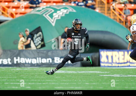 Honolulu, Hawaii, USA. 01st Sep, 2018. September 1, 2018 - Hawaii Rainbow Warriors wide receiver John Ursua #5 runs for a first down during NCAA football game between the Navy Shipmen and the University of Hawaii Warriors at Hawaiian Airlines Field at Aloha Stadium in Honolulu, Hawaii. Glenn Yoza/CSM Credit: Cal Sport Media/Alamy Live News - Stock Photo