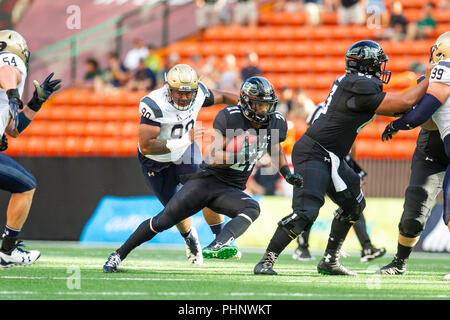 Honolulu, Hawaii, USA. 01st Sep, 2018. September 1, 2018 - Hawaii Rainbow Warriors running back Fred Holly III #21 runs for a first down during NCAA football game between the Navy Shipmen and the University of Hawaii Warriors at Hawaiian Airlines Field at Aloha Stadium in Honolulu, Hawaii. Glenn Yoza/CSM Credit: Cal Sport Media/Alamy Live News - Stock Photo