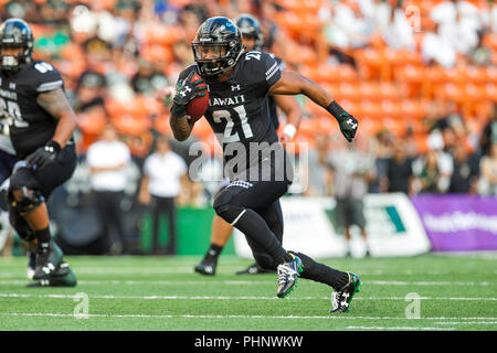 Honolulu, Hawaii, USA. 01st Sep, 2018. September 1, 2018 - Hawaii Rainbow Warriors running back Fred Holly III #21runs the ball during NCAA football game between the Navy Shipmen and the University of Hawaii Warriors at Hawaiian Airlines Field at Aloha Stadium in Honolulu, Hawaii. Glenn Yoza/CSM Credit: Cal Sport Media/Alamy Live News - Stock Photo
