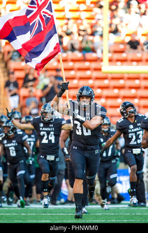 Honolulu, Hawaii, USA. 01st Sep, 2018. September 1, 2018 - Hawaii Rainbow Warriors defensive lineman Kamuela Borden #30 runs on the field carrying the Hawaii flag before the NCAA football game between the Navy Shipmen and the University of Hawaii Warriors at Hawaiian Airlines Field at Aloha Stadium in Honolulu, Hawaii. Glenn Yoza/CSM Credit: Cal Sport Media/Alamy Live News - Stock Photo