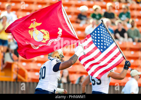 Honolulu, Hawaii, USA. 01st Sep, 2018. September 1, 2018 - Navy Shipmen run on the field carrying the flags before the NCAA football game between the Navy Shipmen and the University of Hawaii Warriors at Hawaiian Airlines Field at Aloha Stadium in Honolulu, Hawaii. Glenn Yoza/CSM Credit: Cal Sport Media/Alamy Live News - Stock Photo