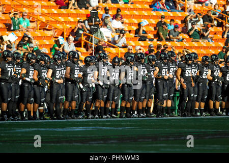 Honolulu, Hawaii, USA. 01st Sep, 2018. September 1, 2018 - Hawaii Rainbow Warriors watch the coin toss before the NCAA football game between the Navy Shipmen and the University of Hawaii Warriors at Hawaiian Airlines Field at Aloha Stadium in Honolulu, Hawaii. Glenn Yoza/CSM Credit: Cal Sport Media/Alamy Live News - Stock Photo