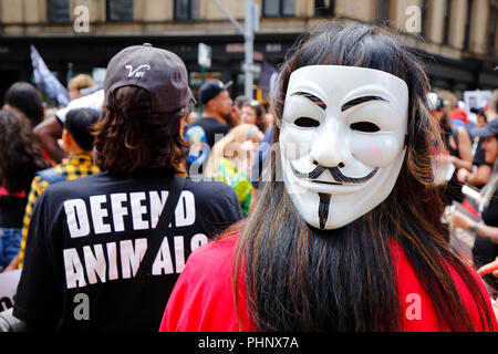 New York, NY, USA. 1st September, 2018. A protester with a Guy Fawkes 'We are Anonymous' mask at a demonstration for animal rights located near Madison Square Park in Manhattan. - Stock Photo