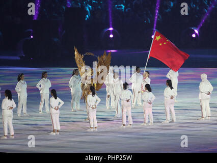 180902) -- JAKARTA, Sept. 2, 2018 (Xinhua) -- China's national flag bearer Guo Dan enters the Gelora Bung Karno (GBK) Main Stadium during the closing ceremony of the 18th Asian Games in Jakarta, Indonesia, Sept. 2, 2018.(Xinhua/Ding Ting) - Stock Photo
