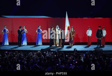 (180902) -- JAKARTA, Sept. 2, 2018 (Xinhua) -- Photo taken on Sept. 2, 2018 shows the flag handover ceremony during the closing ceremony of the 18th Asian Games at the Gelora Bung Karno (GBK) Main Stadium in Jakarta, Indonesia. (Xinhua/Ding Ting) - Stock Photo