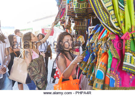 Friends shopping at market - Stock Photo