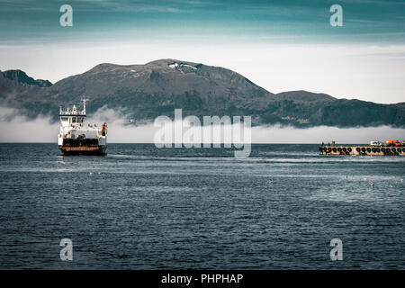 Norwegian Ferry on the Fjord in Volda - Stock Photo