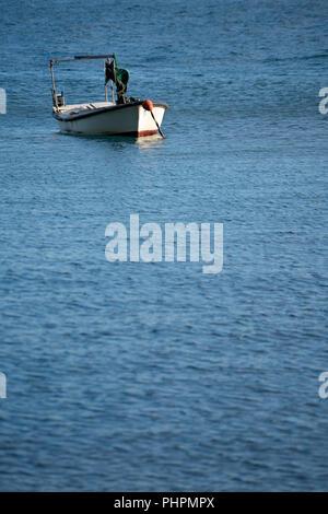 Small empty fisherman boat on a lake - Stock Photo