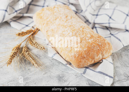 Ciabatta with ears on the table - Stock Photo