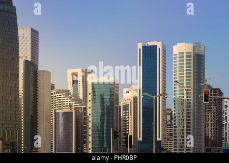 Middle Eastern City Skyline Construction High Rises Sunny - Stock Photo