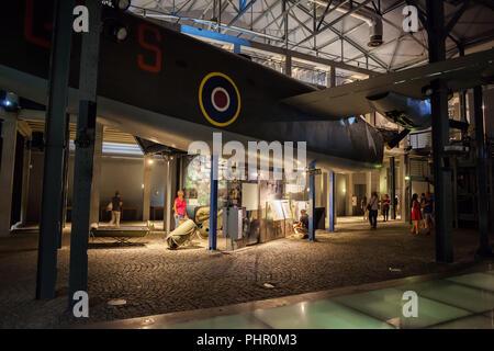 Warsaw Rising Museum (Muzeum Powstania Warszawskiego) interior in Warsaw, Poland, exhibition with Liberator B-24 airplane, an American heavy bomber - Stock Photo