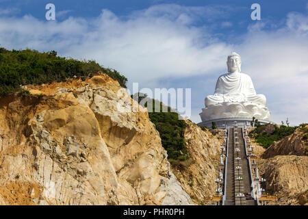 White Buddha Statue Vietnam Steps Cliffs Sunny Asia Religious Monument Landscape - Stock Photo