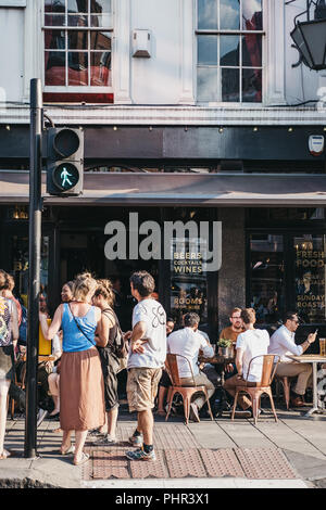 London, UK - July 24, 2018: People drinking outside The Old Crown pub on New Oxford Street, London. You can find reference to The Old Crown in Hogarth - Stock Photo
