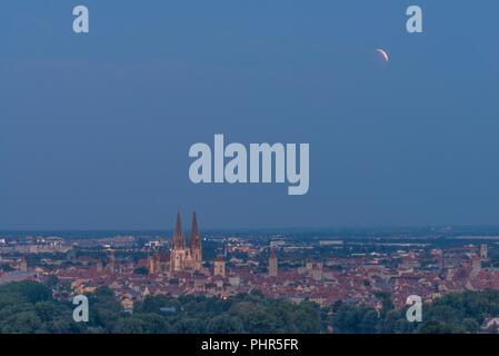 Beginning of the lunar eclipse in July 2018 over Regensburg, Germany - Stock Photo