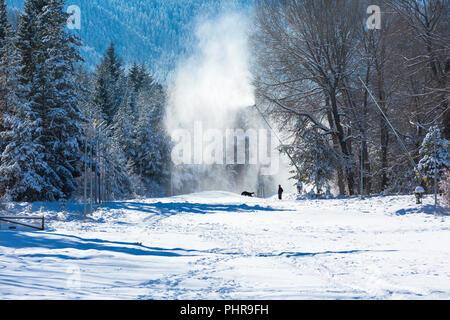 Winter ski resort landscape and snow canons in Bansko, Bulgaria - Stock Photo