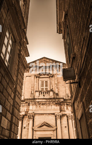 Facade of old historical building in Dubrovnik - Stock Photo