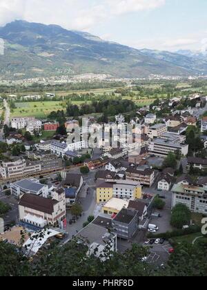 View on cityscape landscape of small european capital city center of Vaduz in Liechtenstein - vertical - Stock Photo