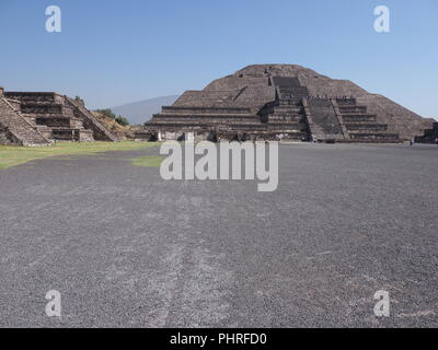 Monumental pyramid of the Moon at Teotihuacan ruins seen from Avenue of the Dead near Mexico city landscape - Stock Photo