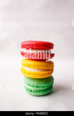 Different kind of macaroons in stack on white background, traffic light sweet conceptual, copy space - Stock Photo