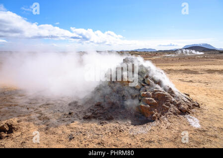Steam vents at the Hverir geothermal spot in northern Iceland - Stock Photo