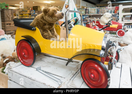 classic yellow pedal car by Great Gizmos on sale in Dobbies garden centre - Scotland, UK - Stock Photo