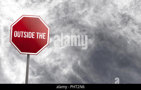 Outside the Box - red sign with clouds in background - Stock Photo