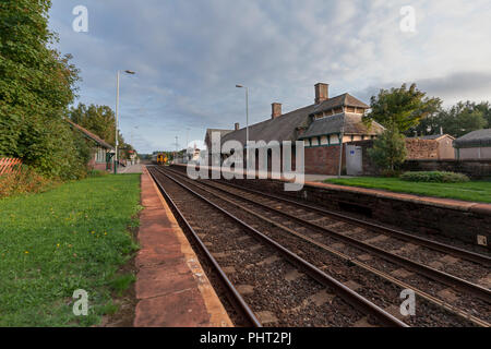 A Arriva Northern rail class 156 sprinter train arrives at Askham In Furness railway station on the Cumbrian coast railway line - Stock Photo