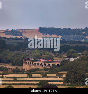 LNER intercity 125 ( still carrying Virgin logos) crossing Wharfedale viaduct (River Wharf, Leeds - Harrogate line) with a Harrogate to London train - Stock Photo