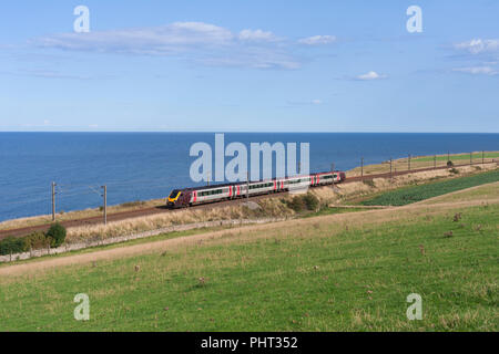 A Crosscountry Trains class 220 voyager train  crossing the English border at Lamberton on the east coast main line. - Stock Photo